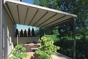 Strong, weather resistant fabric roof system with drainage